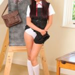 Stephanie W strips out her classic college uniform